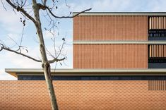 View the full picture gallery of IES Les Aimerigues Lavabo Exterior, Outside Toilet, Architectural Materials, Industrial Architecture, Brick Facade, Brick Design, Construction Process, Exhibition Space, Future City