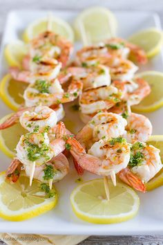 Try these Grilled Lemon Shrimp Kabobs before summer's gone! So yummy and easy, serve these kabobs to your pals for dinner on the deck!