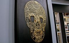 DIY Wall Art: Brass Skull - Maddie would love this but, maybe with a hot pink background in a black frame instead of black on black...