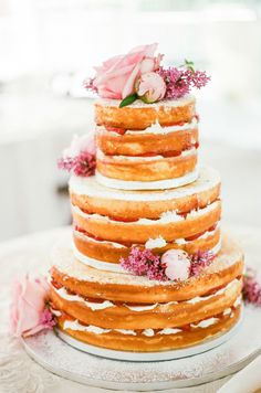 Gorgeous floral topped naked cake: http://www.stylemepretty.com/pennsylvania-weddings/pittsburgh/2016/04/27/elegant-mellon-park-wedding/ | Photography: Palermo Photo - http://palermophoto.com/