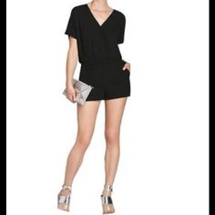 HP BCBG MAX AZRIA Sexy Black Romper  Very pretty cross front black romper w/short sleeves, front pockets, cuffed at hemline.  So soft.  Figure flattering.  Size L.  Brand new with tags.  Please contact me with any of your questions.  I thank you kindly for visiting!  BCBG Max Azria Dresses