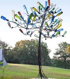 DIY Bottle Tree - C. The Bottle Tree. This is the most beautifully designed tree I've ever s Wine Bottle Trees, Wine Bottle Art, Diy Bottle, Wine Bottle Crafts, Wine Bottles, Glass Bottles, Yard Art, Outdoor Art, Outdoor Gardens