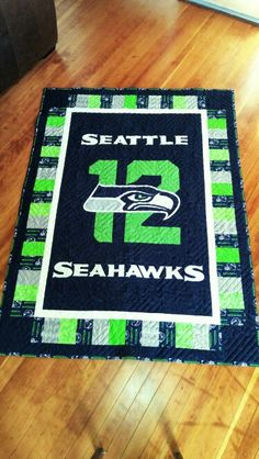Seattle Seahawk quilt I designed and made. Sewing Crafts, Sewing Projects, Sewing Ideas, Sport Themed Crafts, Football Quilt, Sports Quilts, Rag Quilt Patterns, Quilted Table Toppers, Seattle Seahawks