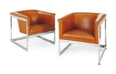 A PAIR OF ORANGE LEATHER AND SILVER METAL CLUB CHAIRS