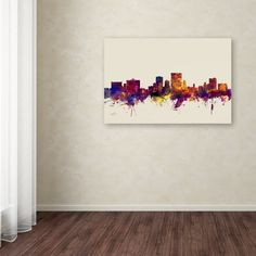 This ready to hang, gallery-wrapped art piece features a watercolor skyline of El Paso, Texas. Art and design were always Michael's favorite subjects at school. He was fortunate to land a job as a gra