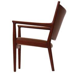 Hans J. Wegner; Teak and Leather Armchair for Johannes Hansen, 1950s.