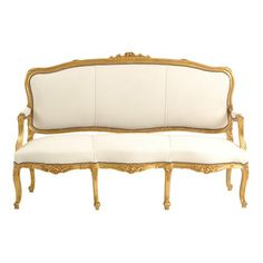 Leopold White Couch at Found Vintage Rentals. White velvet couch with gilt wooden frame