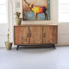 Gain storage space and a handsome piece of rugged furniture with this three-door credenza. Solid acacia lends its incredible grain for an unconventional answer to rustic elegance.  Find the Lodge Three-Door Credenza, as seen in the Modern Log Cabin Collection at http://dotandbo.com/collections/modern-log-cabin?utm_source=pinterest&utm_medium=organic&db_sku=91996