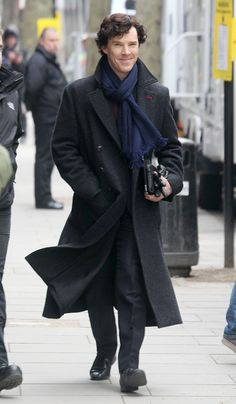 Benedict Cumberbatch filming Sherlock Season 3..... Why does this picture make me grin like an idiot?