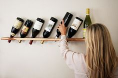 I need this!! I have always wanted a nice way to display wine but have never had enough space for an actual wine rack. This is perfect!