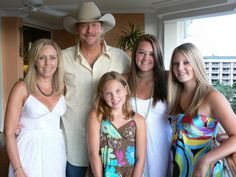 2006: The author and her country star husband pose with their three daughters, Dani, 9, Mattie, 17 and Alie, 13. Jackson family on vacation in Hawaii 2006.