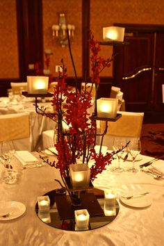 Our elegant centrepiece with a touch of red! #decorit #red #candles #centrepiece #wedding #flowerdecoration #flowers #floraldecoration #flowerdesign  www.decorit.com.au