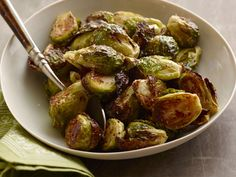 Serve and Add Salt : Serve warm, seasoning with extra salt, if desired.Now that you know how to simply roast Brussels sprouts, try Ree Drummond's Brussels Sprouts with Balsamic and Cranberries.