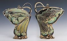 "Butterfly"" 11""x 10""x 3"" This is 2 different sides of the same vase. Slab built, pulled handles, slip trailed, bisque, stained, glazed, glazed again, fired cone 5. http://www.carollongpottery.com/ $885."