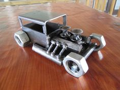 Mini hot rod, welded by JPlaiaSteelArt. Follow JPlaiaSteelArt on Facebook to find and buy unique metal art.