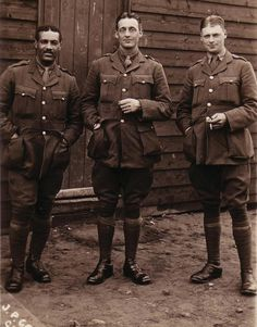 """Second Lieutenant Walter Tull and unnamed British officers. Footballer superstar, Mentioned in Despatches for """"gallantry and coolness,"""" and recommended for a Military Cross before death in 1918."""