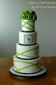 Green and black and white wedding cake.