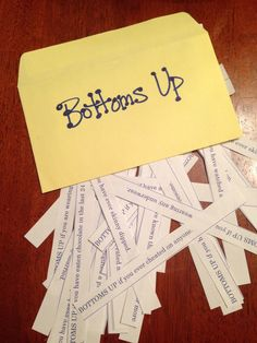 Bottoms Up....  Drinking game for bachelorette party.   Guests draw from the envelope through out the night, creating many rounds of drinking and secrets being shared !!