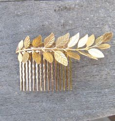 Golden leaf haircomb by Noaki on Etsy.