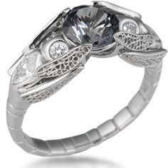 Dragonfly Engagement Ring - Fly, fly, dragonfly! These two beauties together hold a stone with their wingtips. Body can be any gemstone; what's your preference? Marquise side diamonds are an optional feature and are priced separately. Call or email for a quote.