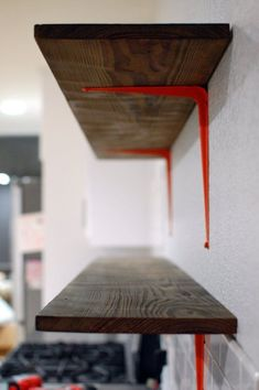spray paint boring cheap-o white shelf brackets to spice up a room