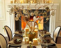 Muted centrepiece - plant a branch in a terracotta pot, add glass ornaments and surround with ivoryand gold accented candles