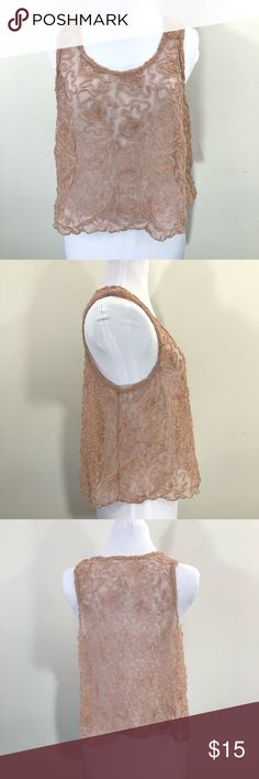 Free People Sheer Textured Mesh Rosette Boho Tank Free People Sheer Textured Mesh Rosette Boho Tank  Deep dusty pink, almost mauve, this tank will be a staple in your summer wardrobe. Throw it on over a cami, a strappy bralette, whatever you wish. It will compliment a pair of jean shorts really well.   Bohemian music festival beach see through floral romantic Free People Tops Tank Tops