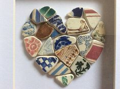 Pretty mosaic beach pottery heart motif picture with multicoloured pottery pieces. This heart mosaic is made from small fragments of pottery washed smooth by years in the sea. All the pieces are hand collected from my local beach in Scotland. I love the variety of beach pottery and like to imagine what the pieces once were and where they have travelled from. The picture is in a box frame measuring 6 x 8. The frame can be either wall mounted or free standing.