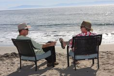 Relaxing on the beach on a lovely afternoon in their SolAir hats!