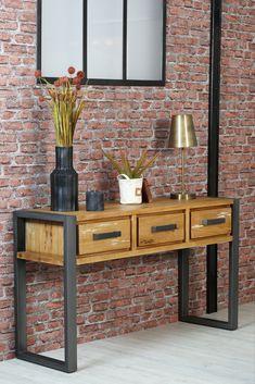 Console d'entrée en bois et métal. Ce meuble BORNEO est fabriqué à partir de bois massif de mindi, brossé pour un aspect authentique, et en métal pour les pieds et les poignées des 3 tiroirs. La console est un meuble pratique pour une entrée ou un salon, et permet d'y ranger quelques affaires et d'y poser des objets de décoration : miroir, plante, lampe... Largeur de la console : 140 cm - profondeur 46 cm. La console BORNEO apportera une touche moderne à votre déco intérieur. Decoration, Contemporary Style, Solid Wood, Furniture, Decor, Decorations, Decorating, Dekoration, Ornament