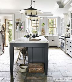 Serious kitchen inspiration! We just love everything about this... from the beautiful grey kitchen island to the unique light fixtures. We can't get enough of  the vintage-rustic vibes...