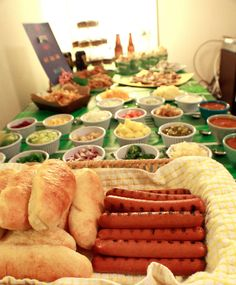 Football Party Food: Hot Dog Bar~T~ Some great ideas for game day food. I think this would be fun with some different sausages like chicken- mango or, chicken, artichoke and sundried tomato etc. Lots of topping ideas.
