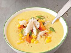 Top corn gazpacho with crab, green onions, corn kernals, and tomato for a refreshing summer soup.