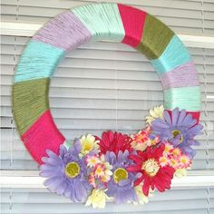 DIY Yarn Wreath There are so many yarn colors you can find for #Easter #decoration! Make a wreath with them, see Ceo of Me for the instructions. #wreath