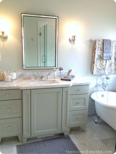 minty green vanity in master bathroom - claw foot tub - master bathroom decorating ideas....maybe more of a gray vanity not green