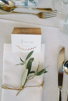 Tie an olive branch to napkins with twine for instant sophistication | Image by Chris Copeland Photography