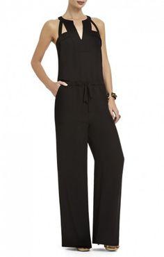 "$186.00 Go for goddess-like charm from brunch to elegant evening soiree in this stunning embellished jumpsuit from BCBGMAXAZRIA. The sleeveless jumpsuit features a round neckline, a metallic embellishment at the neck and an elastic waist. Straight leg. V-neck cutout below embellishment. Button closure at neck back. Measures approximately 32.5"" at inseam. Polyester. Hand wash. Imported"
