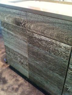 Beautifully textured cabinetry.