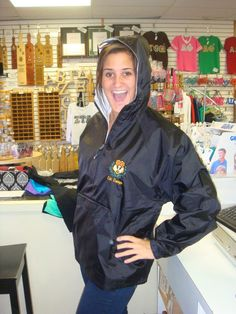 Alli models our new waterproof quarter zip jackets in Chi Omega. This jacket is perfect for keeping dry on your way to class or as you watch intramural games outdoors! Custom Greek Apparel, Greek Clothing, Chi Omega, Be Perfect, Rain Jacket, Windbreaker, Outdoors, Models, Zip