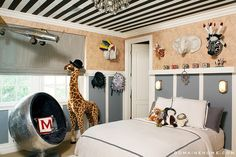Judging from the space's circus-tentlike ceiling and aviator-chic seating option, it doesn't get much cooler than the room for Kourtney Kardashian and Scott Disick's firstborn child. We spy several of Anthropologie's Savannah Story papier-maché busts on the walls, a showstopping aviator ball chair, and Melissa and Doug's majestic giraffe adding some style to the room. Photo: Grey Crawford