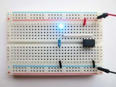 How to connect an ATtiny45 to one blinkin' LED.  Breadboard prototype How To with code to program the ATtiny.  (february 2014)