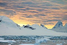 Antarctic sunset in the Antarctic Peninsula. Photograph by Paul Young #AuroraExpeditions