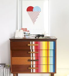 Paint an old dresser for a unique piece that perfectly matches your #nursery decor.  #painteddresser #stripes
