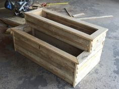 Raised planter bed made entirely from up cycled pallet wood and finishing nails from nail gun.