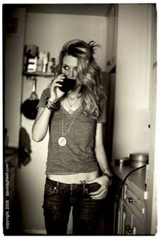 gray t's, low jeans, jewellery, and a glass of red :)