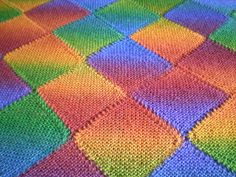 This is a triangular shawl made up of strips of diagonal garter stitch squares which are knitted together as you go. There is no sewing up and you never have more than 31 stitches on your needles. The pattern can be used to make any size of shawl, using any yarn, and could also be used to make a square or rectangular blanket.