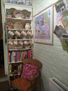 Love this shelf full of pretty China and recipe books...