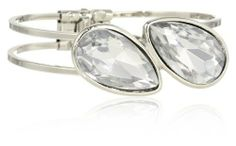 """Kenneth Cole New York """"Urban Crystal"""" Crystal Teardrop Hinged Bangle Bracelet Kenneth Cole New York. $55.00. Silver tone 2 row hinged bangle bracelet, crystal teardrops. Made in China. Silver tone 2 row hinged bangle bracelet, crystal teardrops Made in CN. Items that are handmade may vary in size, shape and color"""