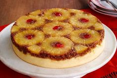 Ingredients: 2 T brown sugar 5 T butter, melted, divided 2 cans (8 oz. each) pineapple slices in juice, well drained 7 Maraschino cherr...