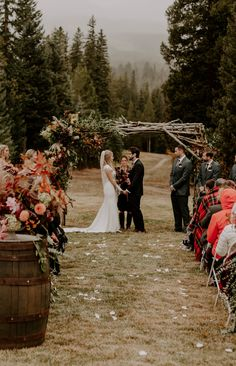 This large wooden ceremony arch features tree branches + lush florals for a rustic feel | Image by Karra Leigh Photography Small Church Weddings, Outdoor Weddings, Rustic Wedding Inspiration, Wedding Ideas, Wedding Planning, Wedding Decorations, Forest Wedding, Cabin Wedding, Fall Wedding